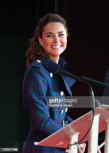 Catherine, Duchess of Cambridge gives a speech as she attends at a unique drive-in cinema to watch a special screening of Disney's Cruella at the...