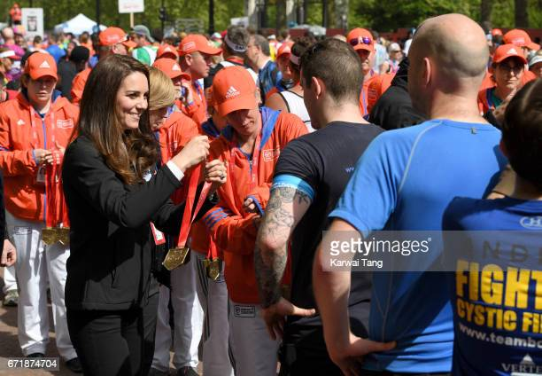 Catherine, Duchess of Cambridge gives out medals to the finishers of the 2017 Virgin Money London Marathon on April 23, 2017 in London, England.
