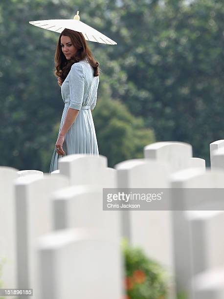 Catherine Duchess of Cambridge glances back at war graves as she leaves Kranji Commonwealth War Cemetery on day 3 of Prince William Duke of Cambridge...