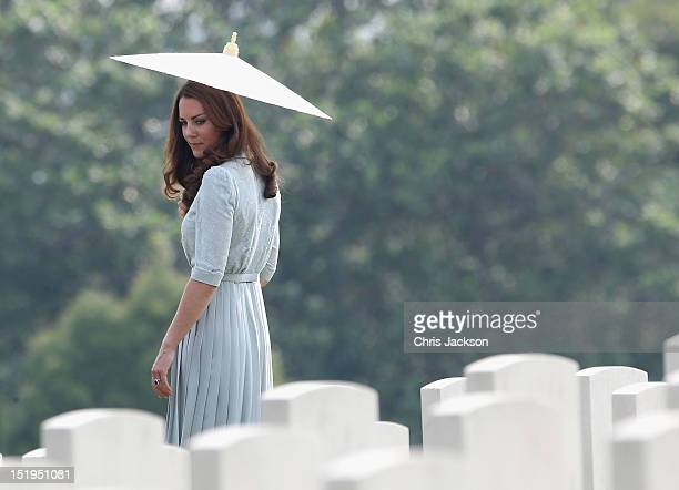Catherine, Duchess of Cambridge glances back at war graves as she leaves Kranji Commonwealth War Cemetery on day 3 of Prince William, Duke of...