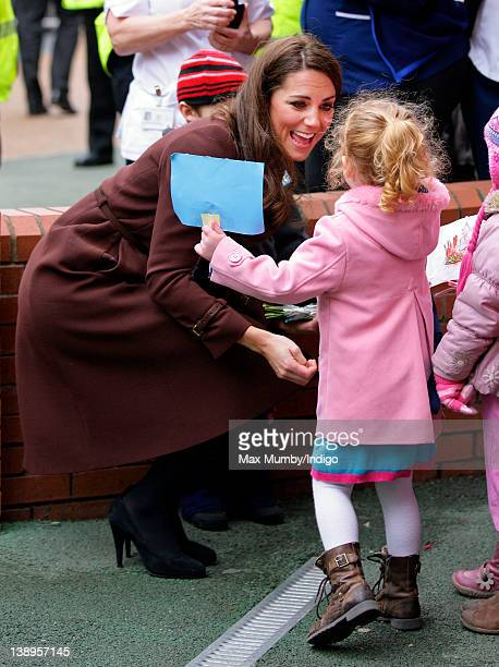 Catherine, Duchess of Cambridge greets a young girl during a walkabout as she visits Alder Hey Children's Hospital on February 14, 2012 in Liverpool,...