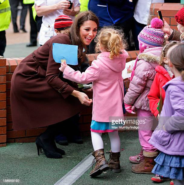 Catherine Duchess of Cambridge greets a young girl during a walkabout as she visits Alder Hey Children's Hospital on February 14 2012 in Liverpool...