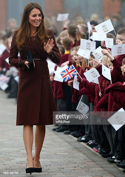 Catherine Duchess of Cambridge greets children during a visit to the Havelock Academy on March 5 2013 in Grimsby England