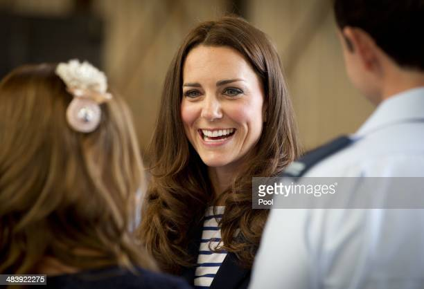 Catherine Duchess of Cambridge greets families of the RNZAF after arriving at Whenuapai on April 11 2014 in Auckland New Zealand The Duke and Duchess...