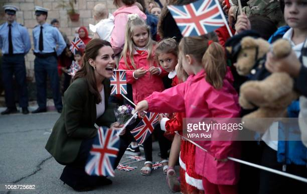 Catherine Duchess of Cambridge greets family members of personnel at the Akrotiri Royal Air Force base during an official visit to meet with Serving...