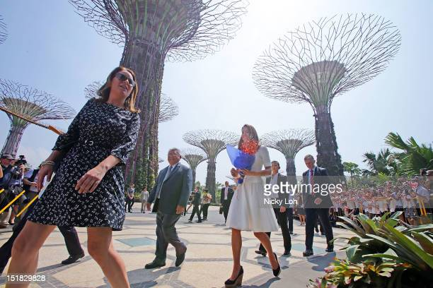 Catherine Duchess of Cambridge greets fans with Prince William Duke of Cambridge as they walk past the super trees during a visit to Gardens By The...