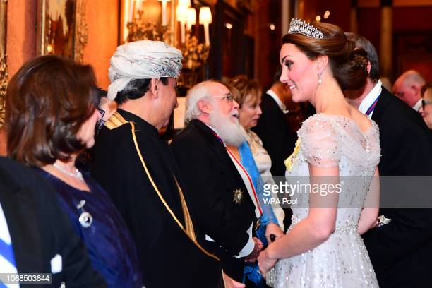 Catherine Duchess of Cambridge greets guests at an evening reception for members of the Diplomatic Corps at Buckingham Palace on December 04 2018 in...