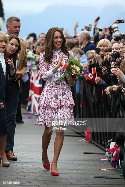 Catherine Duchess of Cambridge greets members of the public after after arriving by sea plane at the Vancouver Harbour Flight Centre during their...