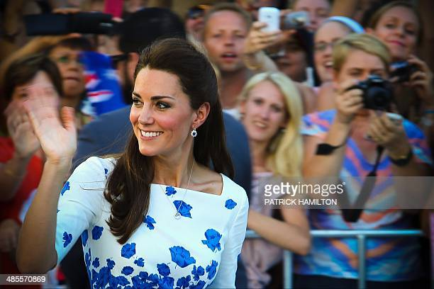 Catherine Duchess of Cambridge greets people during a visit to Southbank in Brisbane on April 19 2014 Britain's Prince William his wife Kate and...