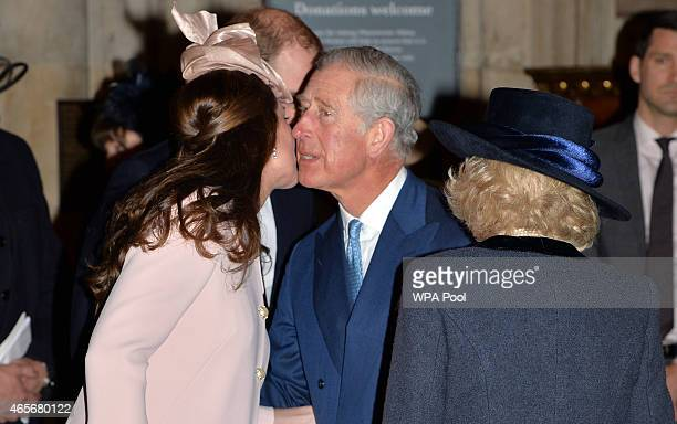 Catherine Duchess of Cambridge greets Prince Charles Prince of Wales as they attend the Observance for Commonwealth Day Service At Westminster Abbey...