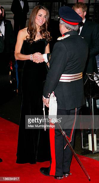 Catherine Duchess of Cambridge greets Sir David Brewer LordLieutenant of Greater London as she attends The Sun Military Awards at Imperial War Museum...