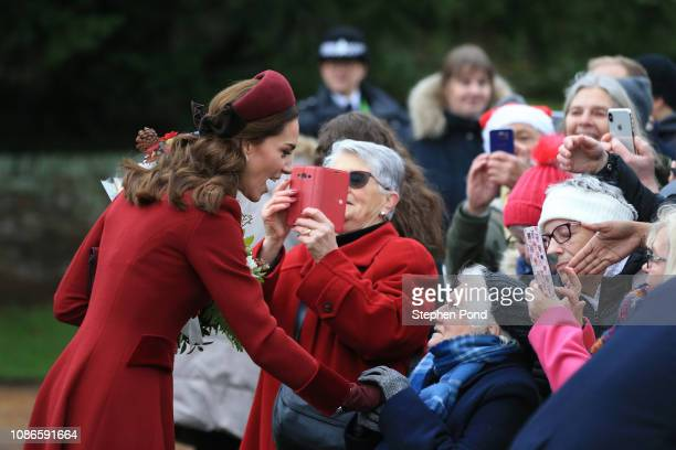 Catherine Duchess of Cambridge greets well wishers as she attend Christmas Day Church service at Church of St Mary Magdalene on the Sandringham...