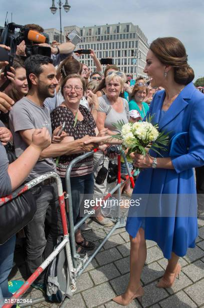 Catherine Duchess of Cambridge greets well wishers on her arrival at the Brandenburg Gate during an official visit to Poland and Germany on July 19...