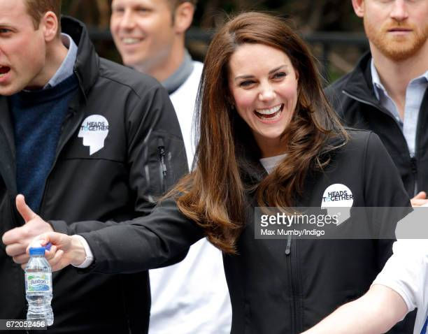 Catherine Duchess of Cambridge hands out water to runners taking part in the 2017 Virgin Money London Marathon on April 23 2017 in London England The...