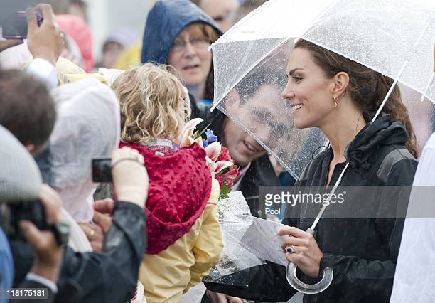 Catherine Duchess of Cambridge has a walkabout in the rain on July 4 2011 at Dalvay by the Sea Prince Edward Island Canada The newly married Royal...