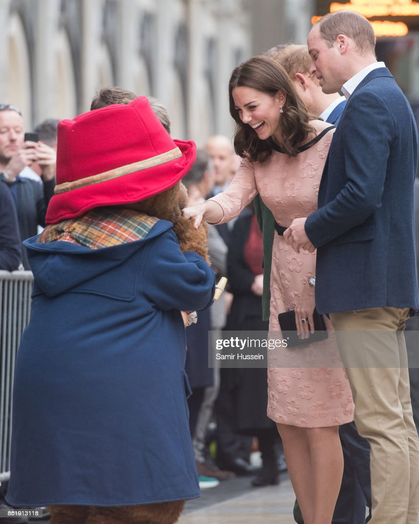 Catherine, Duchess of Cambridge has her hand kissed by Paddington Bear as she attends the Charities Forum Event on board the Belmond Britigh Pullman train at Paddington Station on October 16, 2017 in London, England.
