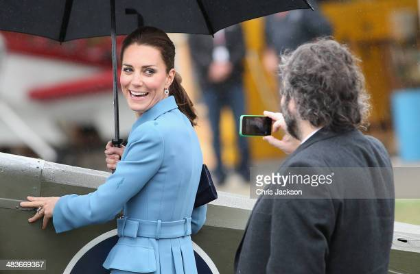 Catherine Duchess of Cambridge has her photo taken on an iphone by Sir Peter Jackson during a visit to Omaka Aviation Heritage Centre on Day 4 of a...