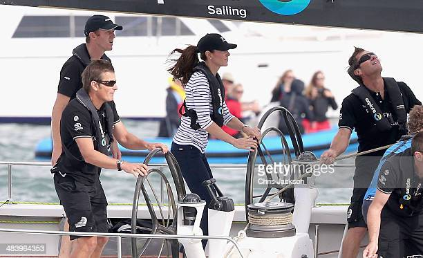 Catherine Duchess of Cambridge helms an America's Cup yacht as she races Prince William Duke of Cambridge in Auckland Harbour on April 11 2014 in...