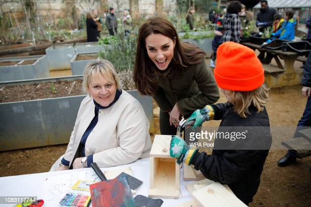Catherine Duchess of Cambridge helps build a bird box as she visits Islington Community Garden on January 15 2019 in London England