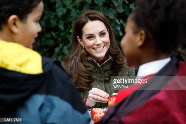 Catherine Duchess of Cambridge helps make winter bird feed as she visits Islington Community Garden on January 15 2019 in London England