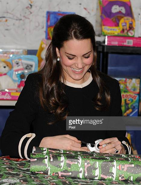 Catherine Duchess of Cambridge helps to wrap Christmas presents during a visit with Chirlane McCray the first lady of New York to the Northside...