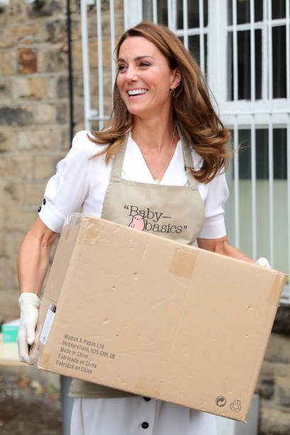 GBR: The Duchess Of Cambridge Visits Baby Basics UK And Baby Basics Sheffield