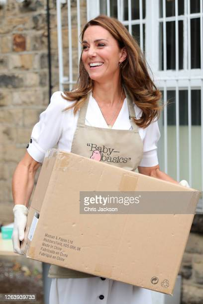 Catherine Duchess of Cambridge helps unloading a pallet of supplies during a visit to Baby Basic UK Baby Basics Sheffield on August 04 2020 in...