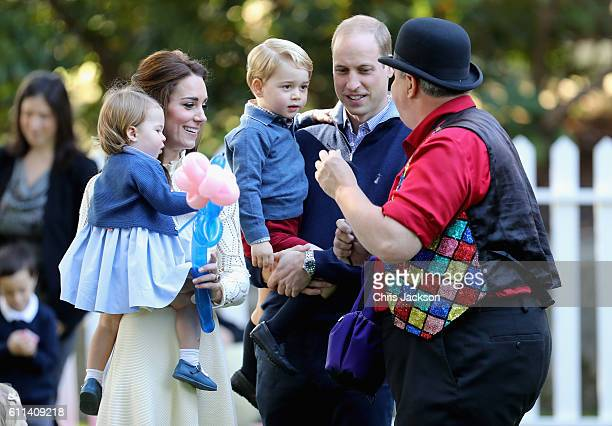 Catherine, Duchess of Cambridge holding Princess Charlotte of Cambridge and Prince George of Cambridge, being held by Prince William, Duke of...