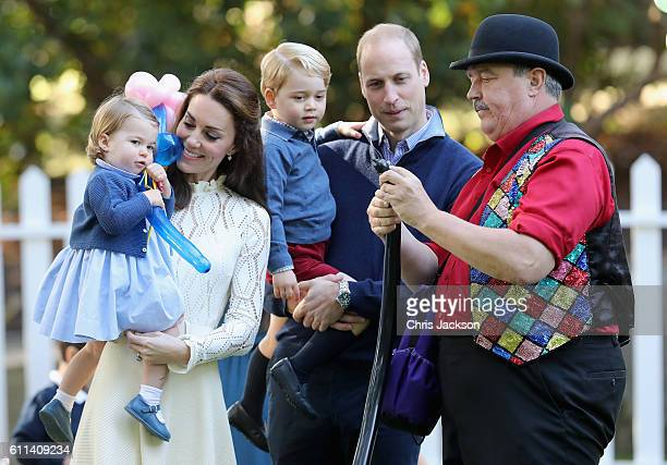 Catherine Duchess of Cambridge holding Princess Charlotte of Cambridge and Prince George of Cambridge being held by Prince William Duke of Cambridge...
