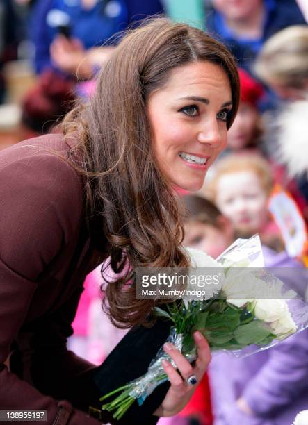 Catherine, Duchess of Cambridge holds a bunch of flowers as she visits Alder Hey Children's Hospital on February 14, 2012 in Liverpool, England.