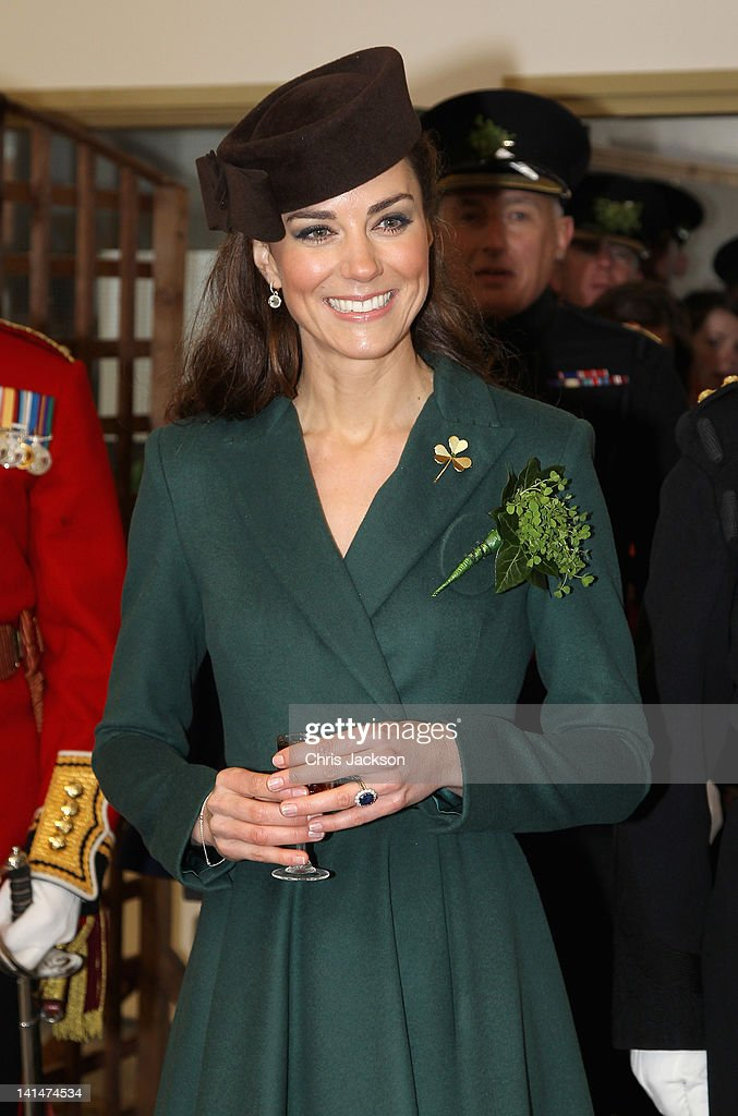 Catherine, Duchess of Cambridge holds a glass of Harvey's Bristol Creme in the Junior's Mess as she visits Aldershot Barracks on St Patrick's Day on March 17, 2012 in Aldershot, England. The Duchess presented shamrocks to the Irish Guards at a St Patrick's Day parade during her visit.