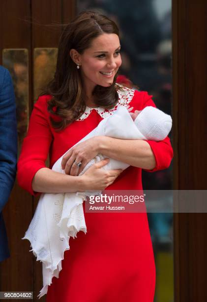 Catherine Duchess of Cambridge holds her newborn son Prince Louis of Cambridge as she leaves the Lindo Wing at St Mary's Hospital on April 23 2018 in...