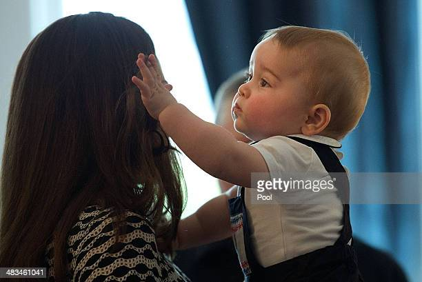 Catherine Duchess of Cambridge holds Prince George of Cambridge during a Plunket nurse and parents group visit at Government House on April 9 2014 in...