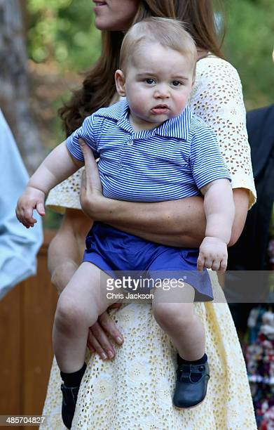 Catherine Duchess of Cambridge holds Prince George of Cambridge as they look at a Bilby called George at Taronga Zoo on April 20 2014 in Sydney...