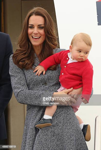 Catherine Duchess of Cambridge holds Prince George of Cambridge as they leave Fairbairne Airbase to head back to the UK after finishing their Royal...
