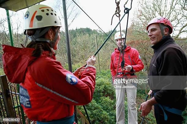 Catherine, Duchess of Cambridge holds Prince William, Duke of Cambridge's support rope as he abseils during a visit to Towers Residential Outdoor...