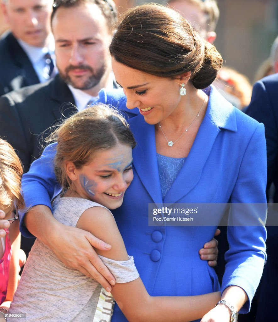 Catherine, Duchess of Cambridge hugs a child as she visits Strassenkinder, a charity which supports young people from disadvantaged backgrounds during an official visit to Poland and Germany on July 19, 2017 in Berlin, Germany.