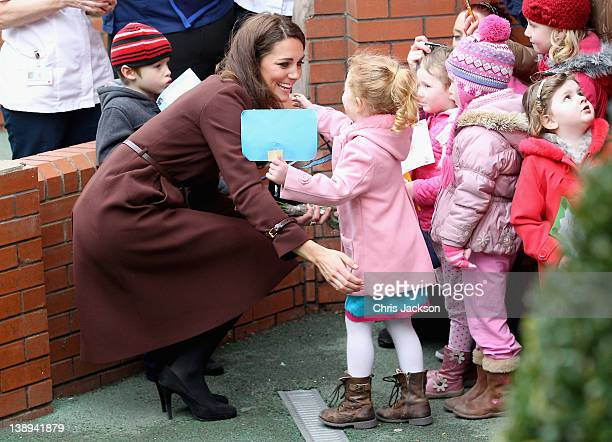 Catherine Duchess of Cambridge hugs a young girl as she visits Alder Hey Children's NHS Foundation Trust on February 14 2012 in Liverpool England The...