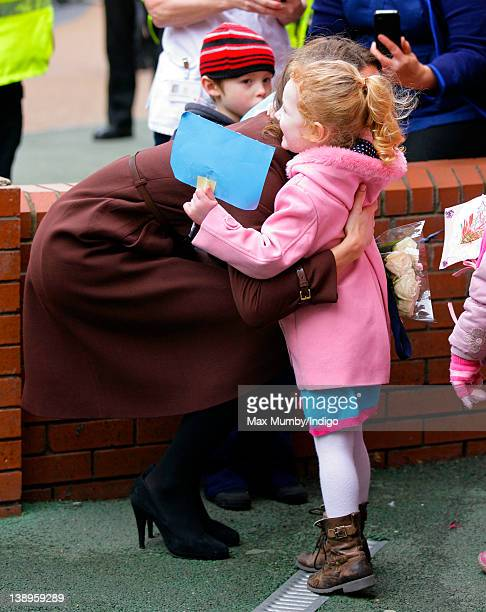 Catherine, Duchess of Cambridge hugs a young girl during a walkabout as she visits Alder Hey Children's Hospital on February 14, 2012 in Liverpool,...