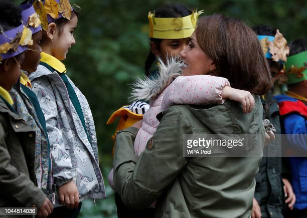 Catherine Duchess of Cambridge hugs Amwaar age 4 as she leaves Sayers Croft Forest School and Wildlife Garden on October 2 2018 in London England...