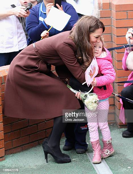 Catherine, Duchess of Cambridge hugs Nancy Williams, aged 3, as she visits Alder Hey Children's NHS Foundation Trust on February 14, 2012 in...
