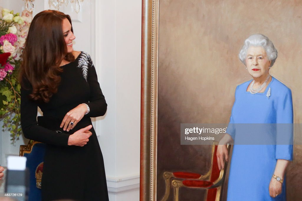 Catherine, Duchess of Cambridge inspects a portrait of Queen Elizabeth II, painted by New Zealand artist Nick Cuthell and unveiled during a state reception at Government House on April 10, 2014 in Wellington, New Zealand. The Duke and Duchess of Cambridge are on a three-week tour of Australia and New Zealand, the first official trip overseas with their son, Prince George of Cambridge.