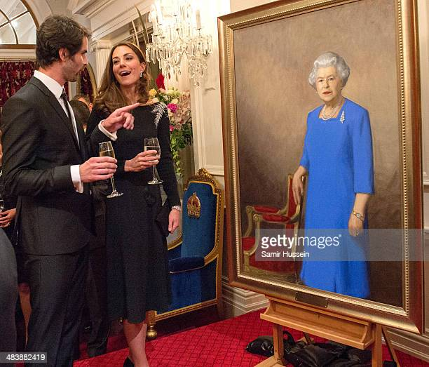 Catherine, Duchess of Cambridge inspects a portrait of Queen Elizabeth II, painted by New Zealand artist Nick Cuthell and unveiled at a state...