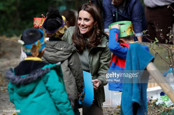 Catherine Duchess of Cambridge interacts with pupils during a visit to Sayers Croft Forest School and Wildlife Garden on October 2 2018 in London...