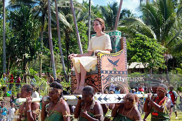Catherine, Duchess of Cambridge is carried from the boat from the dock to the plane in Marau on day 8 of their Diamond Jubilee tour of the Far East...