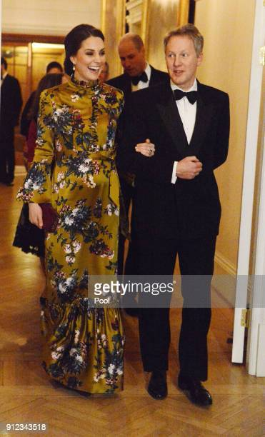 Catherine Duchess of Cambridge is escorted by the British Ambassador to Sweden David Cairns for dinner at the British Ambassador's residence during...