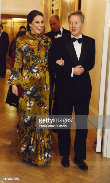 Catherine Duchess of Cambridge is escorted by the British Ambassador to Sweden David Cairns at a reception dinner at the British Ambassador's...