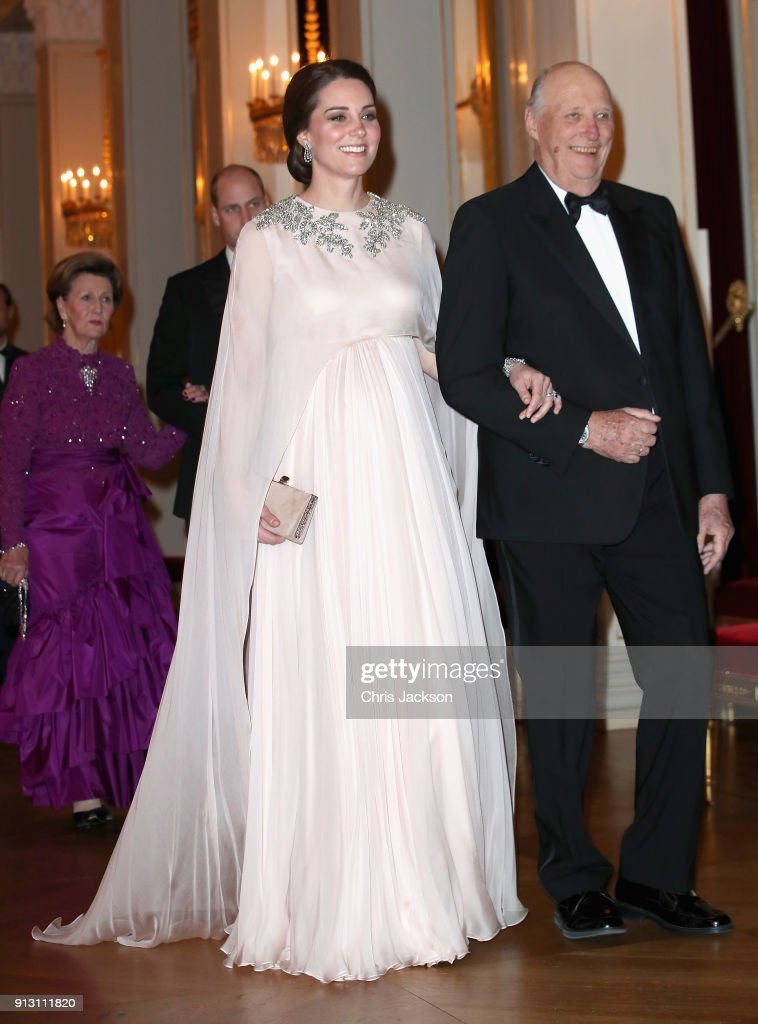 Catherine, Duchess of Cambridge is escorted into dinner by King Harald V of Norway at the Royal Palace on day 3 of her visit to Sweden and Norway with Prince William, Duke of Cambridge on February 1, 2018 in Oslo, Norway.