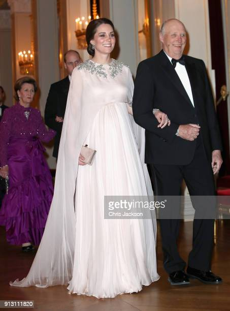 Catherine Duchess of Cambridge is escorted into dinner by King Harald V of Norway at the Royal Palace on day 3 of her visit to Sweden and Norway with...