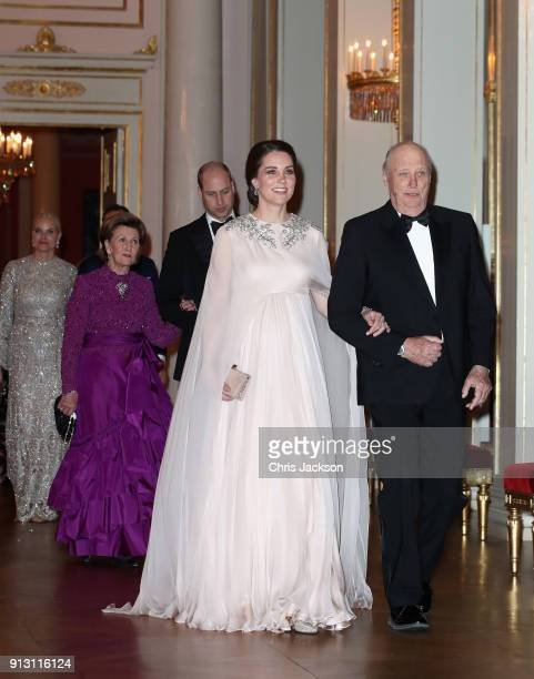 Catherine Duchess of Cambridge is escorted into dinner by King Harald V of Norway followed by Prince William Duke of Cambridge ecorted by Queen Sonja...